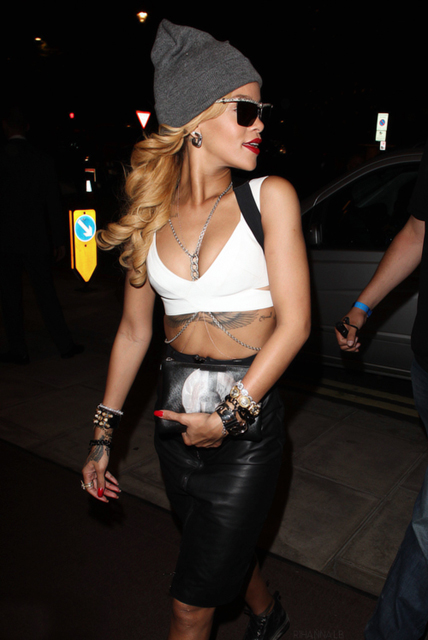 Rihanna-clubbing-party-chic-2013-fashion-in-a-white-crop-top-high-waisted-leather-skirt-crystal-belly-body-chain-a-gray-beanie-sneakers-and-a-Givenchy-Madonna-clutch-pouch-1