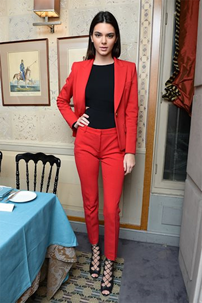 Kendall-Jenner-Tabithat-Simmons-Collection-launch-in-an-Emilo-Pucci-red-wool-suit-from-the-Fall-2014-line